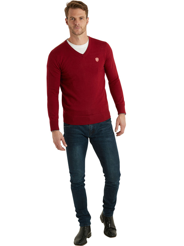 Bunker Mentality Red 100% Merino Wool V Neck Mens Golf Sweater - Model in Jeans