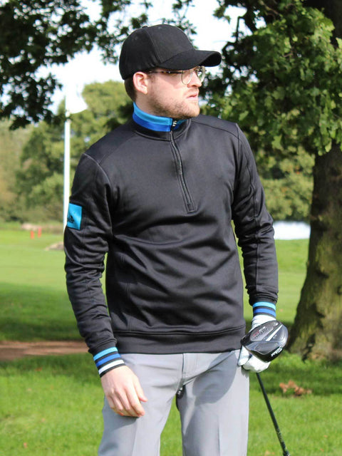 Bunker Mentality Black Golf Mid Layer Sweater with Tri Colour Rib on Collat and Cuffs and Blue patch on left arm - model