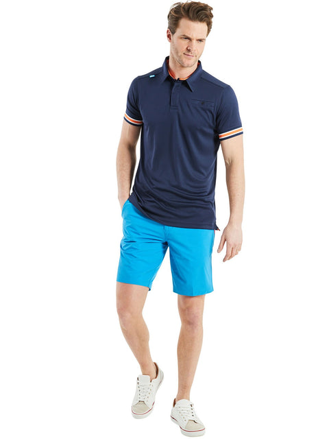 Bunker Mentality Cmax Navy Mens Golf Shirt with contrast orange and White tipping - Model Wearing Blue Triple Stripe Golf Shorts