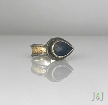 Pear shaped Blue Sapphire Gold dusted Ring