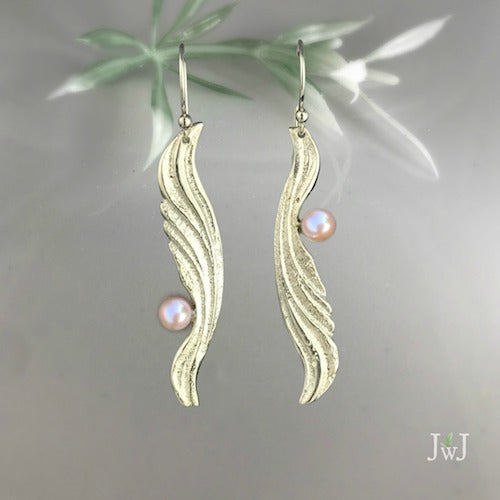 Ripple Wing Earrings with cultured pearl. Ocean-inspired jewellery.