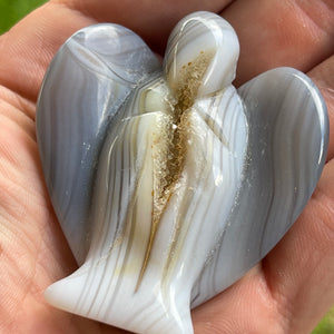 Hand Carved Agate Angel with natural Geode