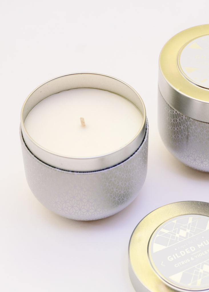 GILDED TIN CANDLE IN CITRUS & VIOLET HAZE BY CAPRI BLUE