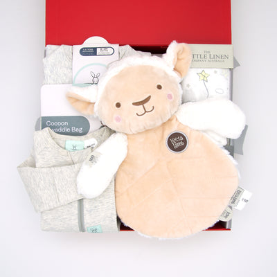 Time to count sheep little one!  This cute gender neutral hamper includes an organic sleep time romper In soft grey marle and matching 1.0 tog sleeping bag which is great for extra warmth as the weather begins to cool.  Also featured is the super cuddly Leesa lamb who's always ready for bedtime snuggles and soft  Starlight muslin for swaddling. A thoughtful, gender neutral gift beautifully presented in our chic, red, signature memory box. $139.00