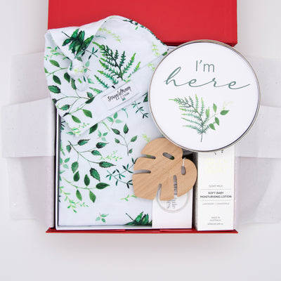 This enchanting baby hamper is a lovely gender neutral baby shower gift or for parents waiting for a new arrival. Included - Snuggle Hunny jersey set and milestone cards, Gilly Goat moisturising lotion and My Little Giggles monstera beech wood teether.   All gifts are presented in our chic, red , signature memory box. $145.00
