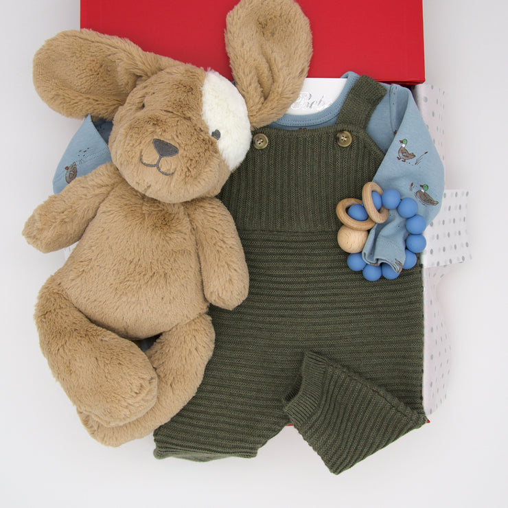 The charming Puddles baby hamper makes you think of wintery walks to feed the ducks, but watch out for Duke who loves to chase. This practical hamper of winter warmers includes knit overalls, a cute duck bodysuit, handy silicone teether and the very cuddly Duke dog.  All gifts are presented in our chic, red, signature memory box. $169.00
