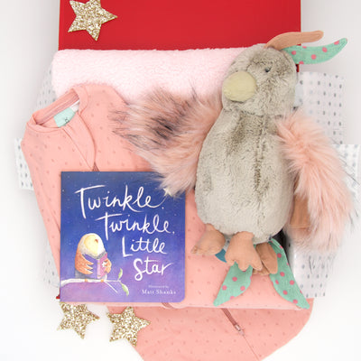 Tucked up in her ergoPouch sleeping swaddle, listening to the sweet melody of Twinkle Twinkle Little Star sung by Mrs Parrot, it is good night, sleep tight for little miss.  Also include in this lovely bedtime hamper is a super soft Sherpa bassinet blanket and Twinkle Twinkle Little Star board book. All items are beautifully presented in our chic, red, signature memory box. $169.00