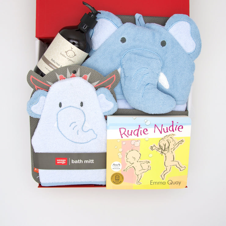Eddie Elephant bathtime hamper is a thoughtful and very cute gift.  The towel, bath mitt and sweet scented hair and body wash will delight little one, whilst at bedtime the classic book Nudie Rudie a belly laugh for all.    All gifts are beautifully presented in our chic, red, signature memory box. $99.00