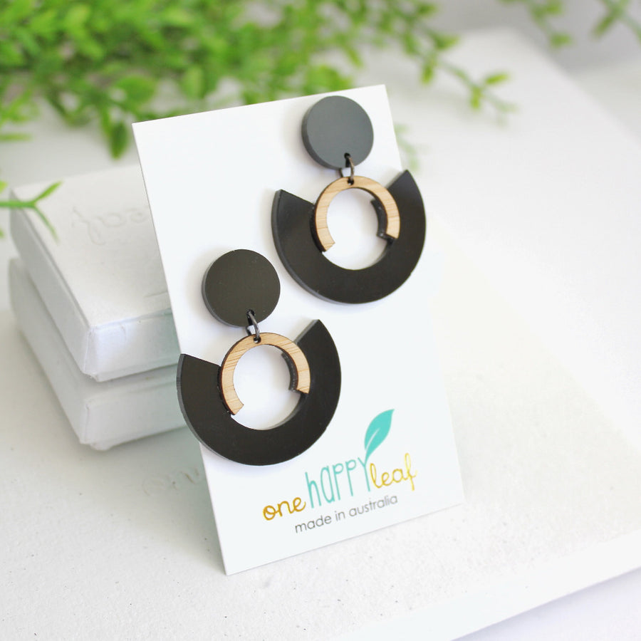 Large black statement earrings