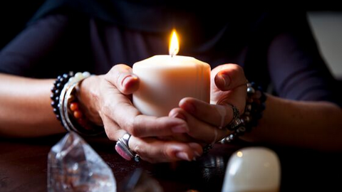 Craft Your Sadhana Workshop, woman with rings holding single candle.