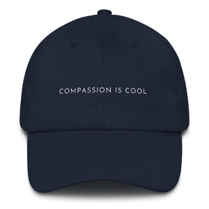 Navy blue embroidered empowering women's statement baseball hat. 'Compassion is cool' Ethically made. Still cute AF. [minimalist apparel//sweatshop free]