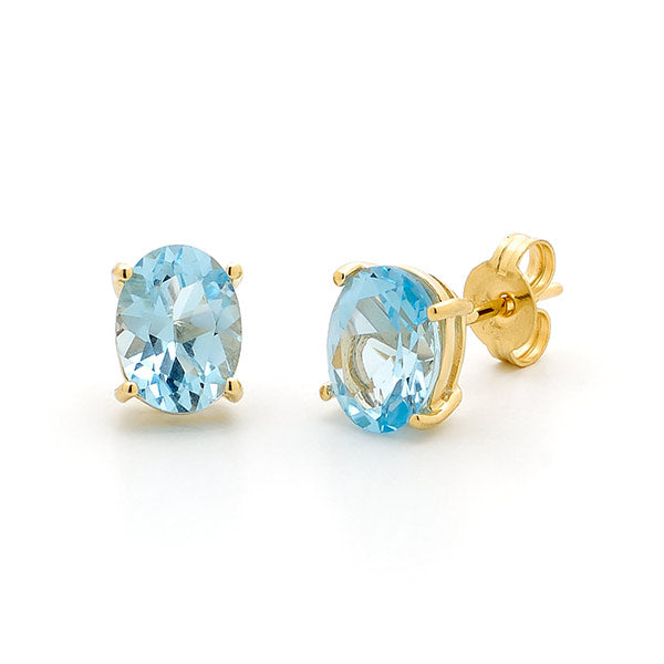 9ct Yellow Gold Blue Topaz Claw Stud Earrings