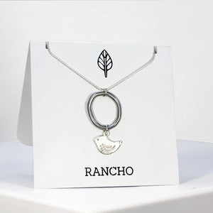 ring and bird on silver chain necklace