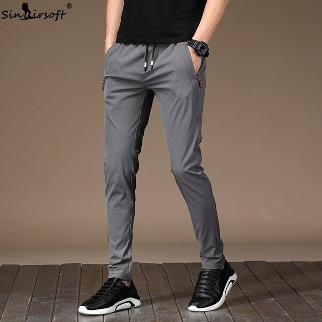 Men's Summer Casual Sport Pants Men Elastic Nine Pants Small Feet Joggers Pants Drawstring Beam Pants Versatile Trousers Homme