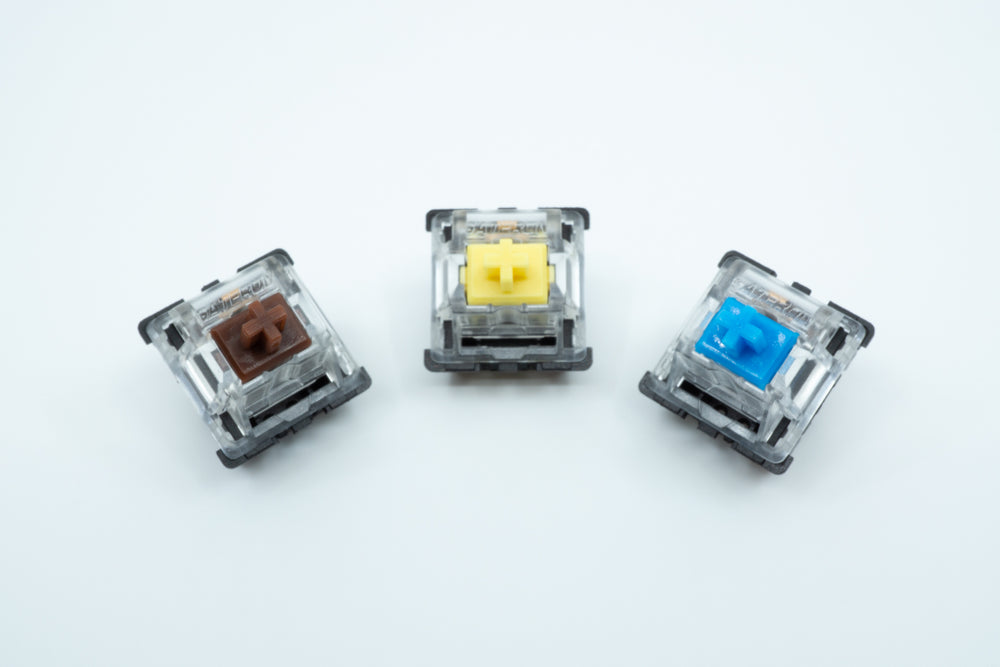 A Gateron Brown, Gateron Yellow and Gateron Blue switch next to each other.