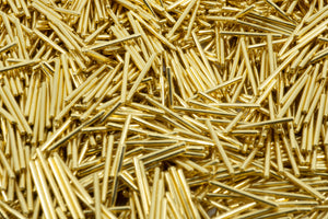 A macro photo filled with gold plated Mill Max pins.