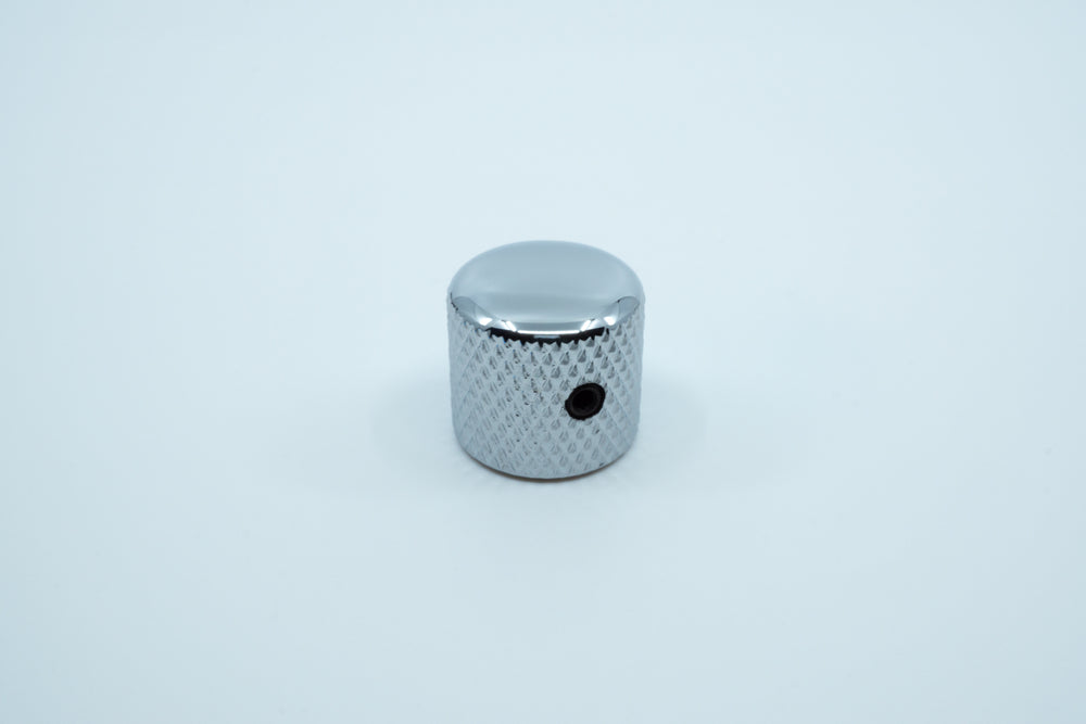 A photo showing the side of the shiny knurled metal encoder knob.