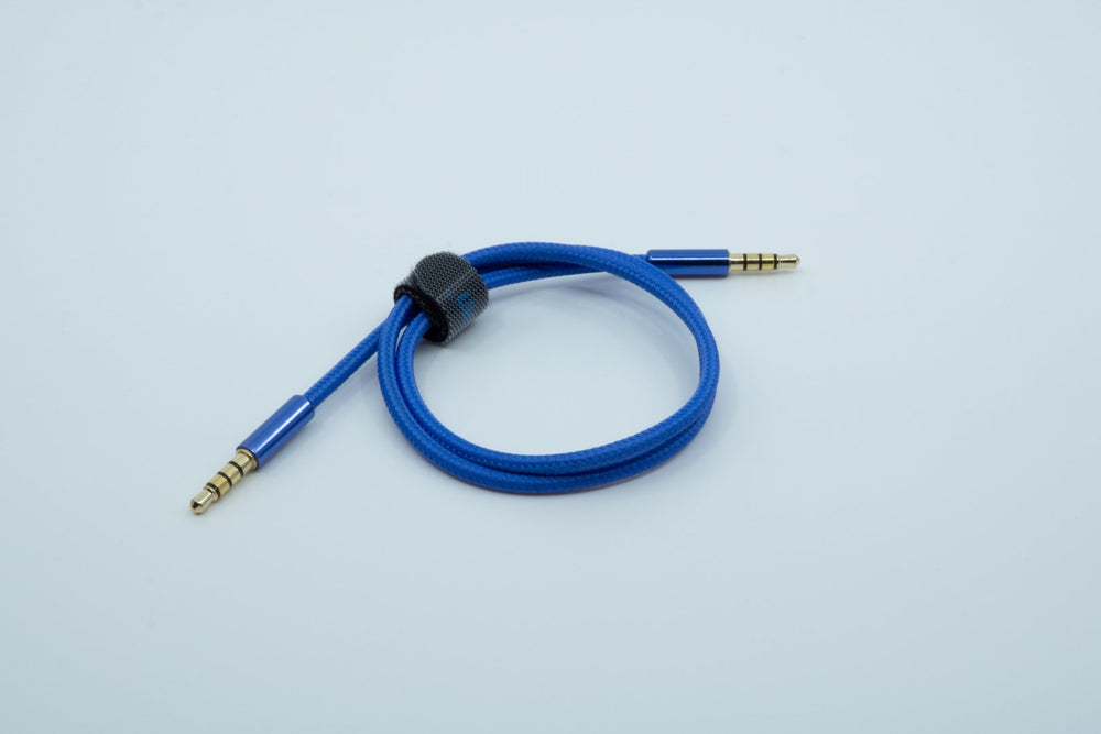 A blue TRRS cable, with an outer housing of braided fabric, bundled with a piece of velcro.