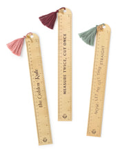 metal ruler with tassel and charm