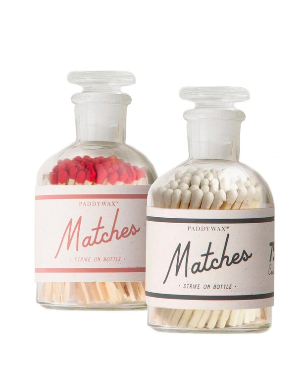 red & white tip matches in decorative glass jars