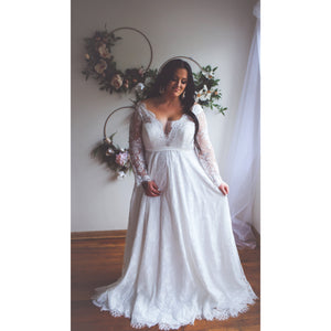 Plus Size bride in lace long sleeve wedding gown