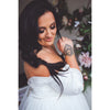 bride with hand tattoo and black hair braided looking over shoulder