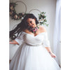 Silk pleated bodice of plus size ivory princess ball gown