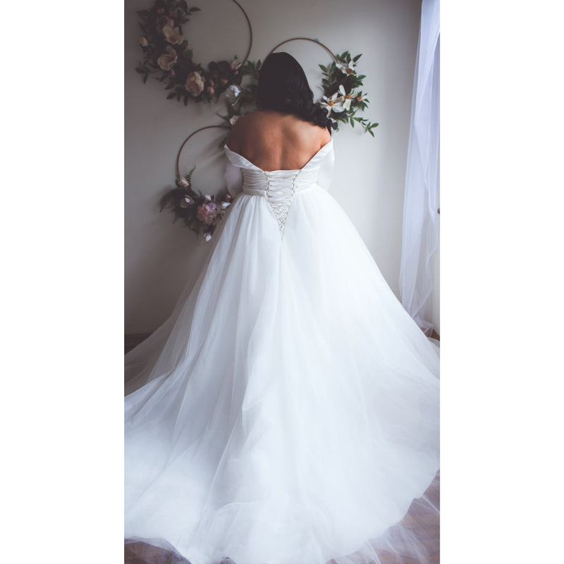 back of plus size wedding gown with a corset back