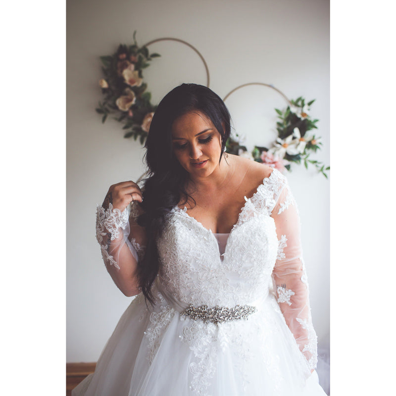 Close up of lace bodice v neck wedding dress
