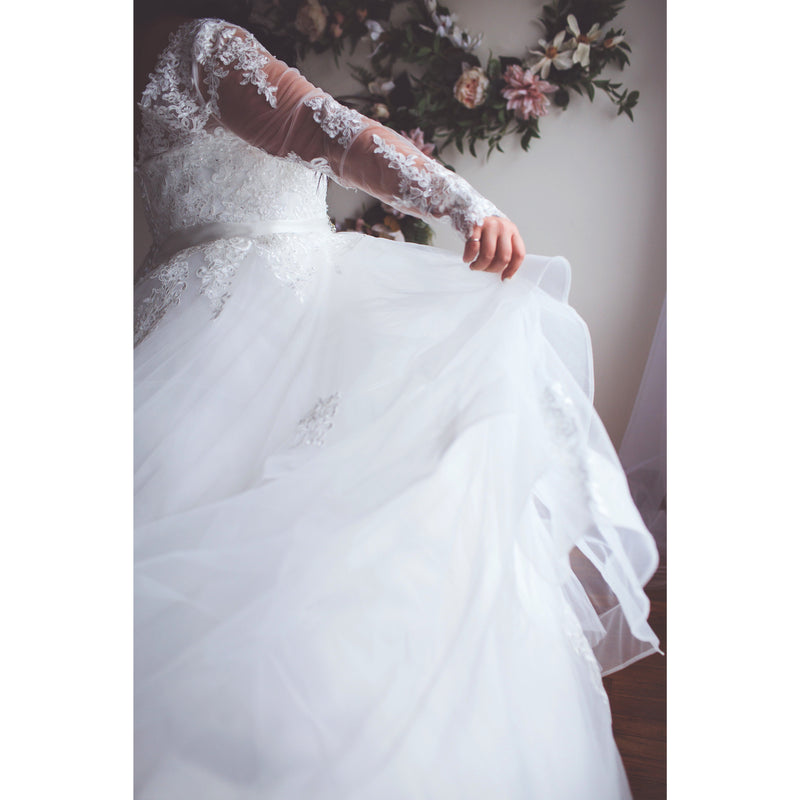 Plus Size bride twirling in gown