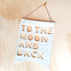 White 'To the moon and back' banner
