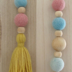 Blonde wood and felt ball drop garland