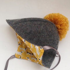 Mustard and grey pompom bonnet 0-6months