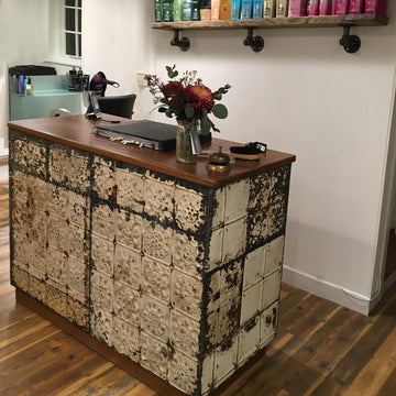 Vintage Haberdashery Counter with reclaimed ceiling tile cladding