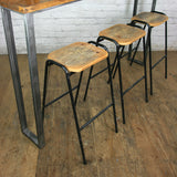 A Set of Three Rustic Bar Height Stools