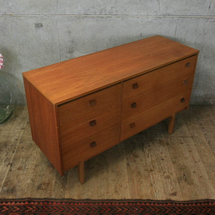 vintage_teak_mid_century_stymbol_chest_of_drawers