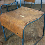 A Set of Four (4) Vintage Tubular Steel Stacking Chairs - BLUE
