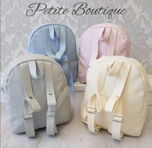 Spanish pink/camel bow backpack