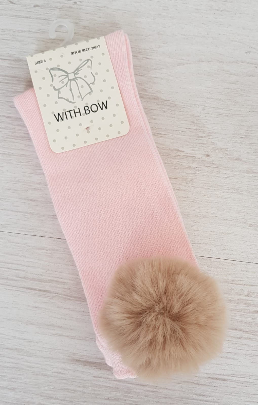 Pink knee high socks with camel faux fur pompoms