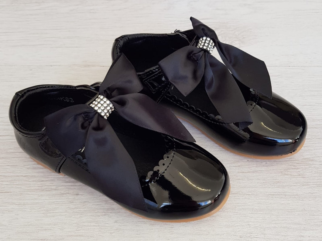 Black patent ribbon shoes