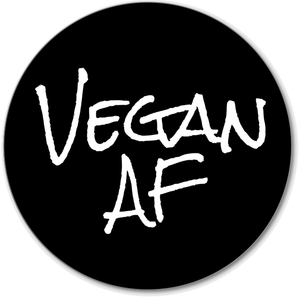 Vegan AF Premium Vinyl Die Cut Decal. It is a black circle with our white Vegan AF logo on it.