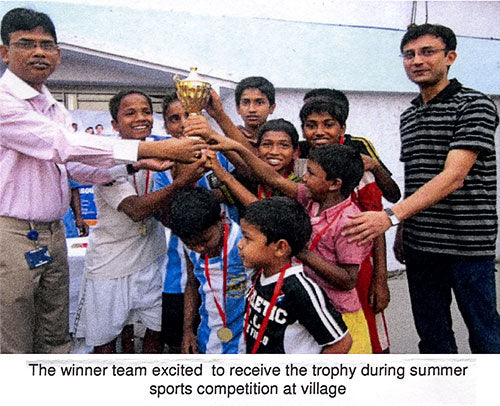 The winner team excited to receive the trophy during summer sports competition at village