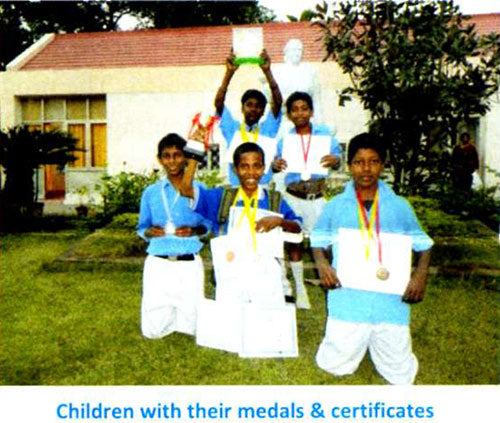 Children with their medals and certificates