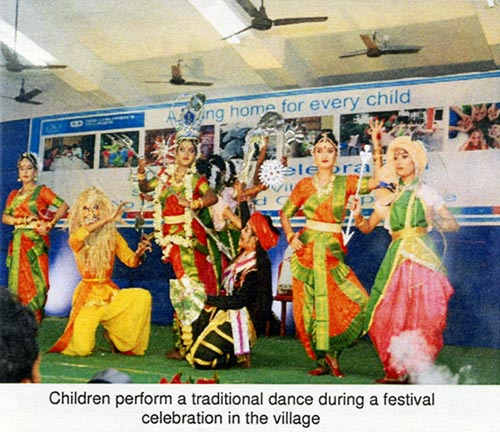 Children perform  a traditional dance during a festival celebration in the village
