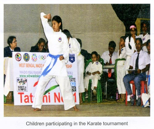 Children participating in the karate tournament