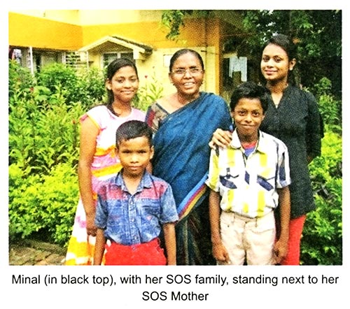 Minal (in black top), with her SOS family, standing next to her SOS Mother