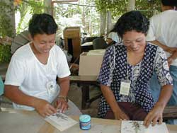 Women making cards by hand at Salay