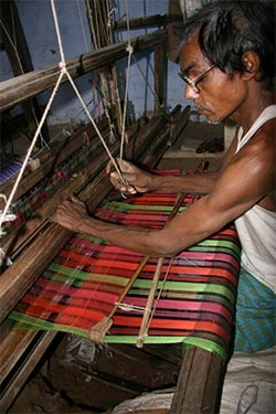 Worker using a traditional handloom