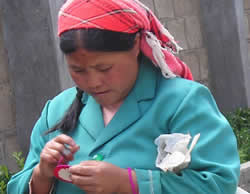 Lady embroidering at Threads of Yunnan, China