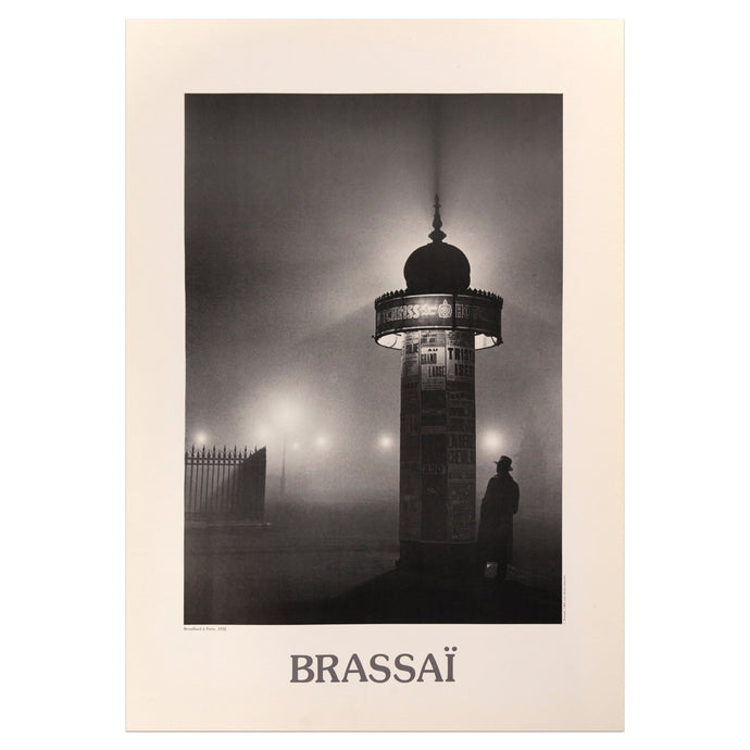 Brassaï poster featuring a black and white photograph of a man standing under a light in a foggy night